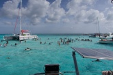A view of Stingray City. Lots of boats come out and bring tourists to stand with the stingrays.